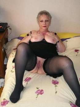 Blonde old woman in black bra and..