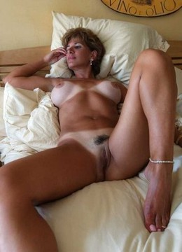 Tanned milf lady on the bed - exciting..