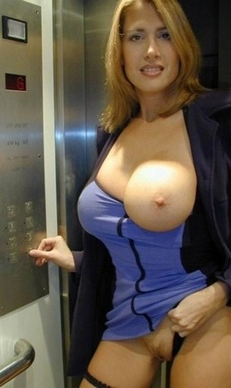 Milf with big breasts flashes pussy in..