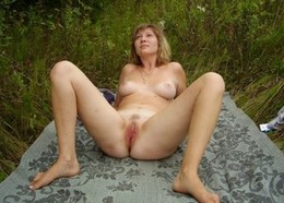 Mature woman spreading her legs and..
